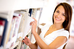 Woman at the library Stock Images