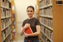 Woman in the library. With the book Stock Photos