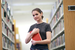 Woman in the library Royalty Free Stock Photography