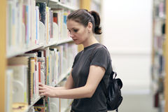 Woman in the library Stock Photos
