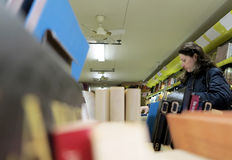 Woman in library. Woman looking for books in library of the Latin Quarter of Paris Stock Photos