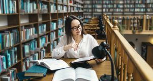 Student Studying at the Library royalty free stock photography