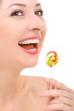 Woman Licking Candy On White Background Stock Photo