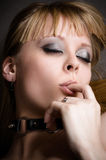 Woman licking her finger. Beautiful woman licking her finger Stock Photo