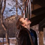 Woman licking icicles Stock Photo