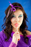 Woman Licking Lollipop Royalty Free Stock Photography