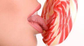 Woman licking lollipop Royalty Free Stock Image