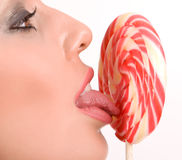 Woman licking lollipop Stock Photos