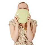 Woman licking plate stock photos