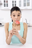 Woman licking sweet sugar candy. Closeup royalty free stock photography