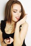 Woman licking tongue caviar Royalty Free Stock Photo