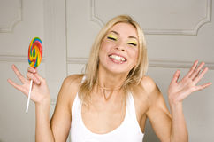 Woman licks candy with beautiful make-up Stock Image