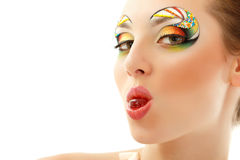 Woman licks candy with beautiful make-up isolated Stock Photo