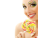 Woman licks candy with beautiful make-up Royalty Free Stock Photo