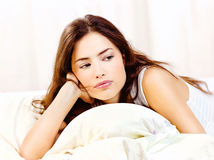 Woman lie in bed at home Royalty Free Stock Images