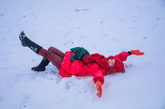 Woman lie down in snowfield Stock Photo