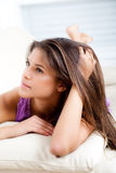 Woman lie down on sofa. Beautiful woman lie down on sofa royalty free stock images