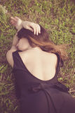 Woman lie on  grass Stock Photos