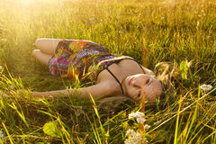 Woman lie on the grass. Young cute woman lie on the grass in the field Stock Images