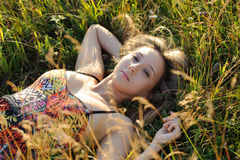 Woman lie on the grass Royalty Free Stock Photography