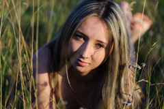 Woman lie on the grass. Young cute woman lie on the grass in the field Stock Photo