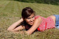Woman lie on green grass Royalty Free Stock Image