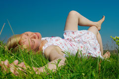 Woman lie on green grass Royalty Free Stock Photography