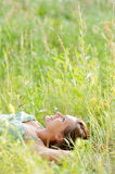 Woman lie in the park. Pretty young woman lie in the park Royalty Free Stock Images