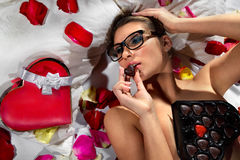 Woman Lieing In Flower Petals Royalty Free Stock Images