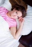 Woman lies Stock Image