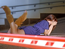 Woman lies in a garage Royalty Free Stock Photography