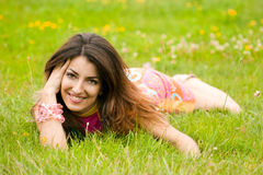 Woman lies on a grass Royalty Free Stock Photo