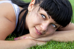 Woman lies on grass Stock Photos