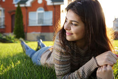 Woman lies on the lawn Royalty Free Stock Image