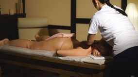 A woman lies on a massage back and relaxes stock video