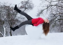 A woman lies on a snowy heart Royalty Free Stock Images