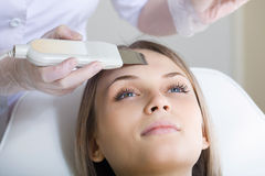 Woman lies on a table in a beauty spa Stock Photography