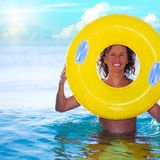 Woman with life buoy. Funny woman with life buoy in the ocean Stock Image