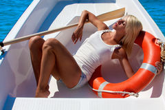 A woman in a lifeboat. Heat. Royalty Free Stock Photos