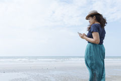 Woman Lifestyle Using A Smartphone On The Beach Stock Photo
