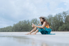 Woman Lifestyle Using A Smartphone On The Beach Royalty Free Stock Images