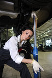Woman lift car in repair center Royalty Free Stock Photo