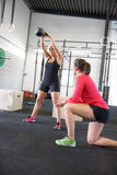 Woman lift kettlebells with personal trainer Royalty Free Stock Photos