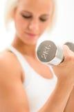 Woman lifting 2KG dumbbells exercise biceps Royalty Free Stock Image