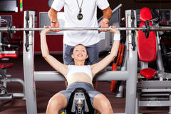 Woman lifting barbell Royalty Free Stock Image