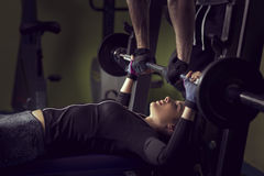 Woman lifting a barbell Royalty Free Stock Photography