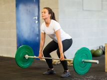 Woman Lifting Barbell Royalty Free Stock Photos