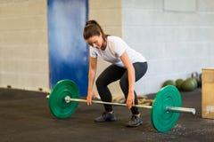 Woman Lifting Barbell At Gym Stock Photos