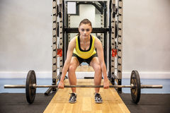 Woman lifting barbell and weights Stock Photo