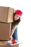 Woman Lifting Boxes stock photo